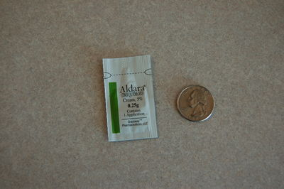 Aldara with quarter